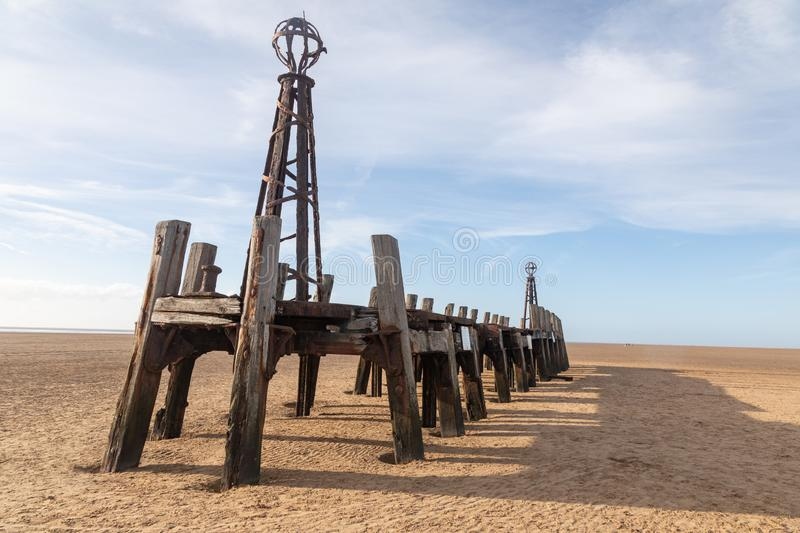 Wooden structure on the beach at St Annes on Sea Fylde Coast February 2019. Wooden structure designed to limit waves on the pier on the beach at St Annes on Sea stock photos