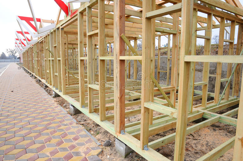 The wooden structure of the building. Roofing Construction. Wooden Roof Frame House Construction.  royalty free stock image