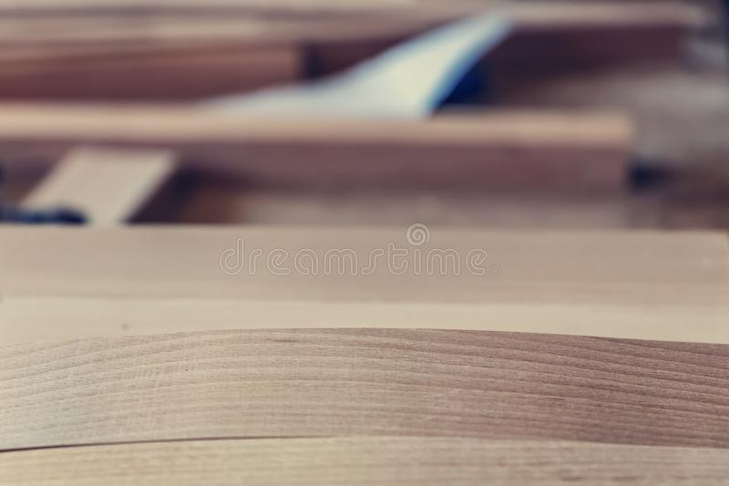 Wooden structure planks, texture of wood and blurred space. woodworking workshop. for joinery. Wood processing. Joinery work. wood stock photo