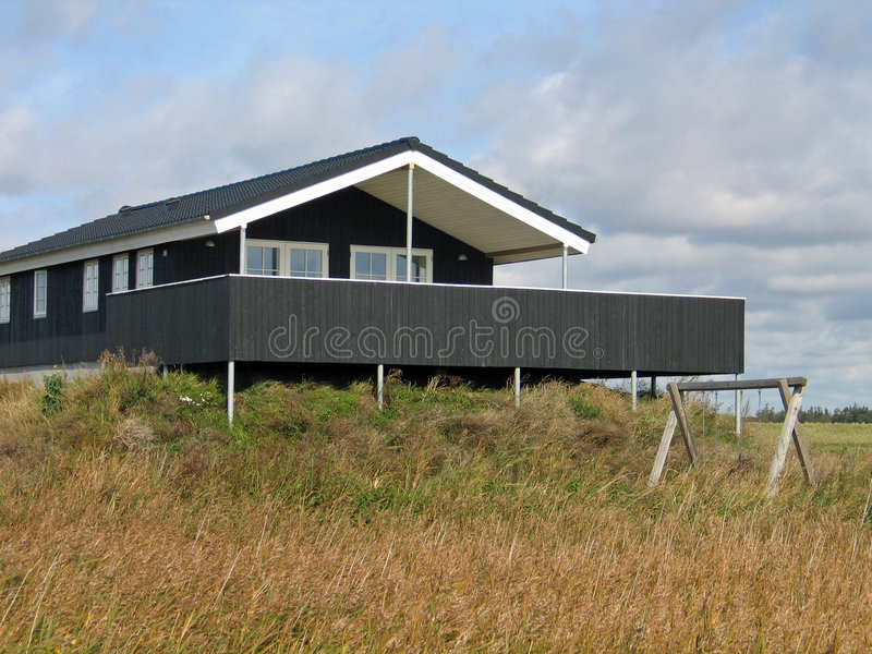 Wooden summer house Denmark. Summer vacation home on the coast in Blavand area Denmark stock photography