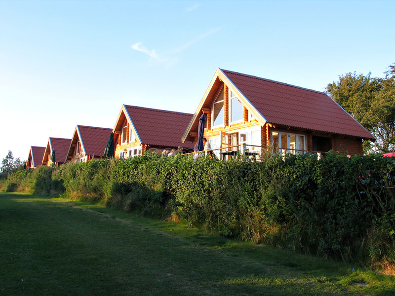 Wooden summer houses. In a vacation village royalty free stock image