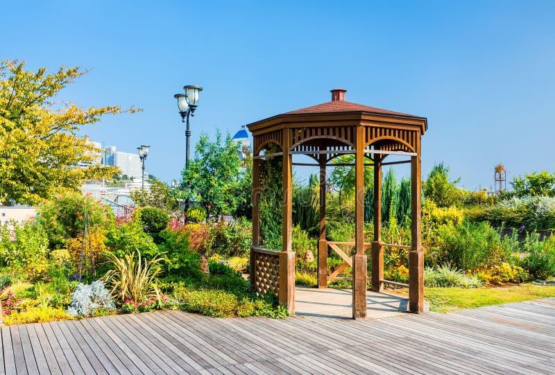 Wooden summerhouse in seaside park royalty free stock image