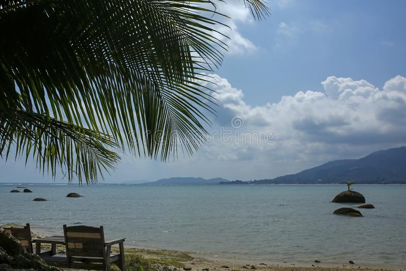 Wooden sunbeds on tropical beach Lamai, Koh Samui, Thailand. Wooden sunbeds on beautiful tropical beach Lamai, Koh Samui, Thailand royalty free stock photo
