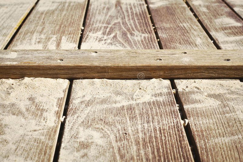 Wooden surface. Close up of a wooden surface with sand on it royalty free stock photo