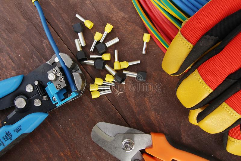 Cable Stripping with Stripping tool stock photos