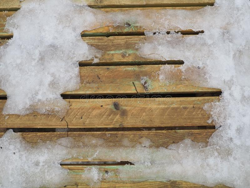 Wooden surface covered with snow stock photography