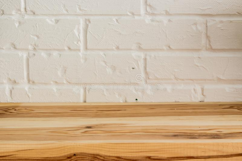 Wooden surface on a white brick background stock images