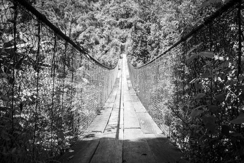 Suspension Bridge Guatemala Black and White. Wooden suspension bridge over river in Panajachel, Guatemala, Central America in black and white stock photography