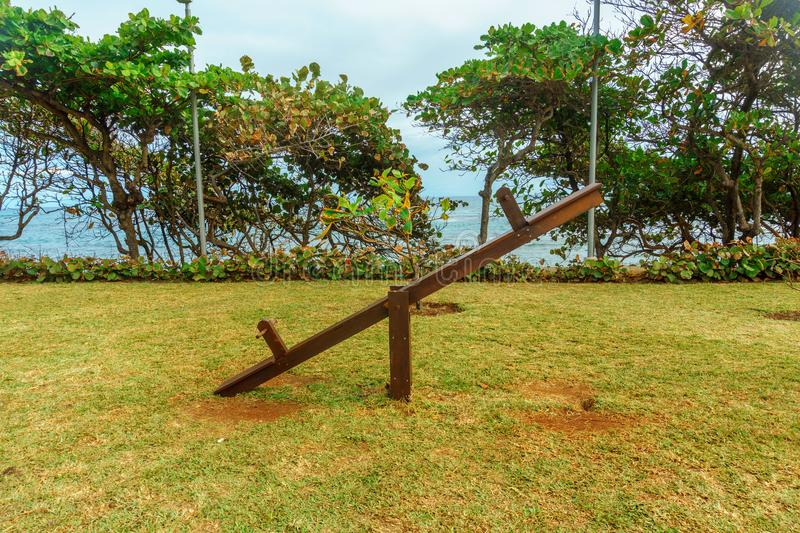 Wooden swing balancer on the lawn in the Park royalty free stock photos