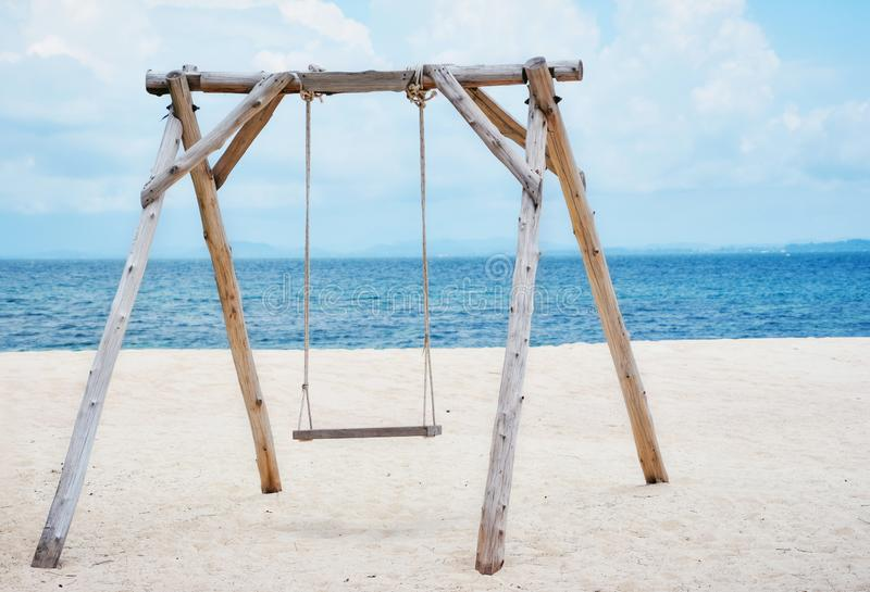 Wooden swing on the beach and Blue Ocean Sea Water Landscape Seascape.,copy space.,Thailand royalty free stock images