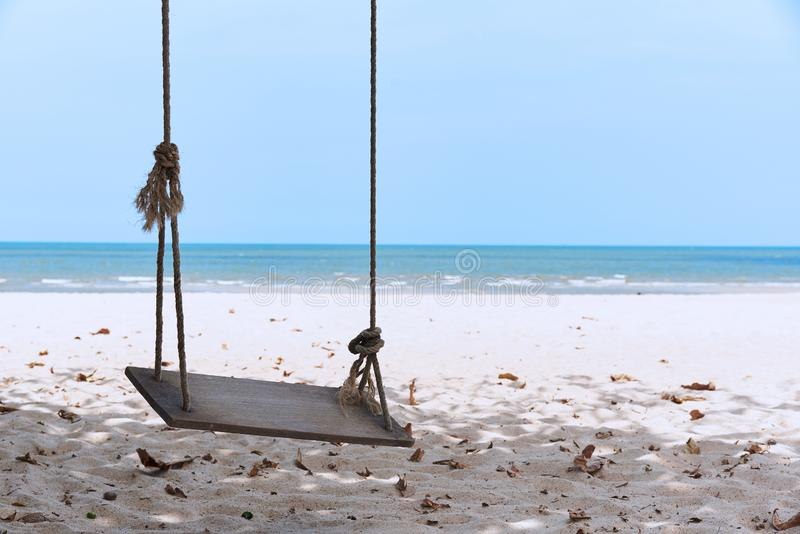 A wooden swing on the beach stock photos