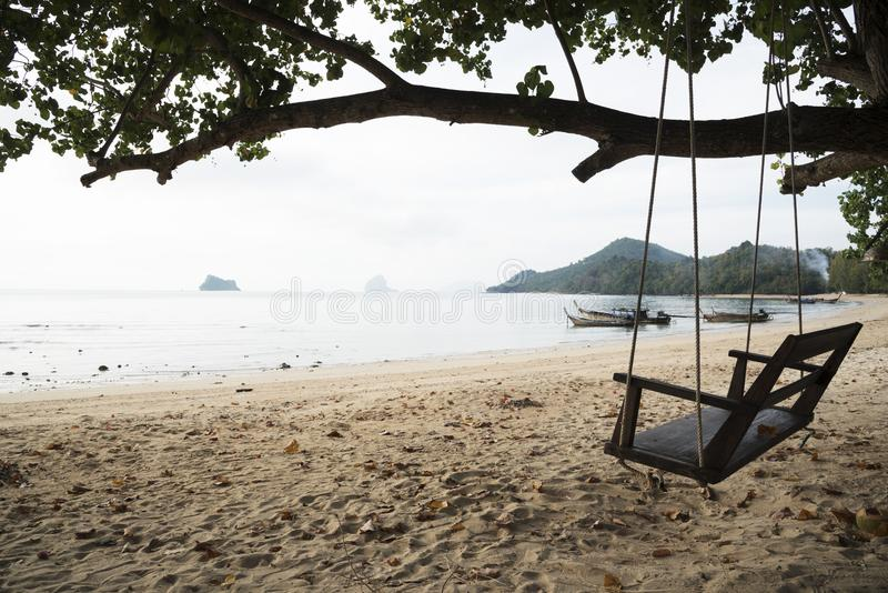 A wooden swing on the beach of Thailand stock image