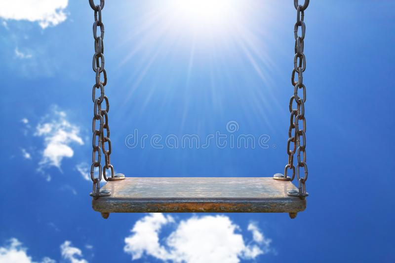 wooden swing with blue sky royalty free stock image
