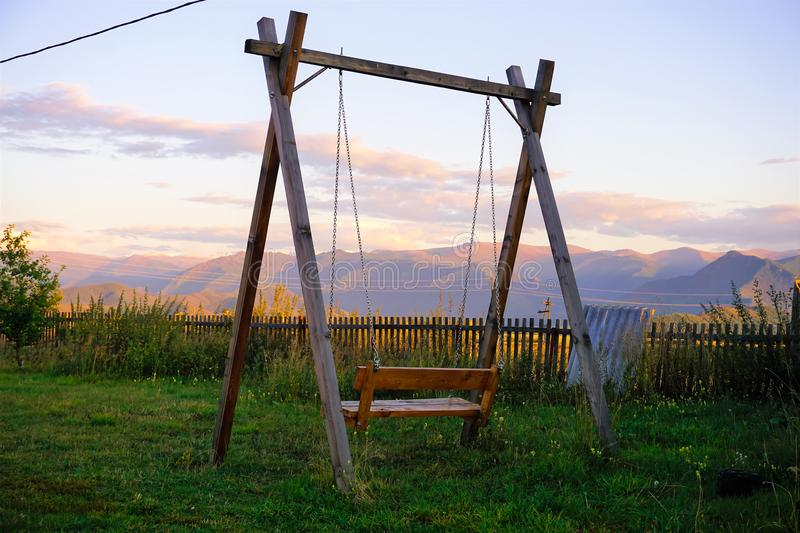Swing with a view of the mountains stock images