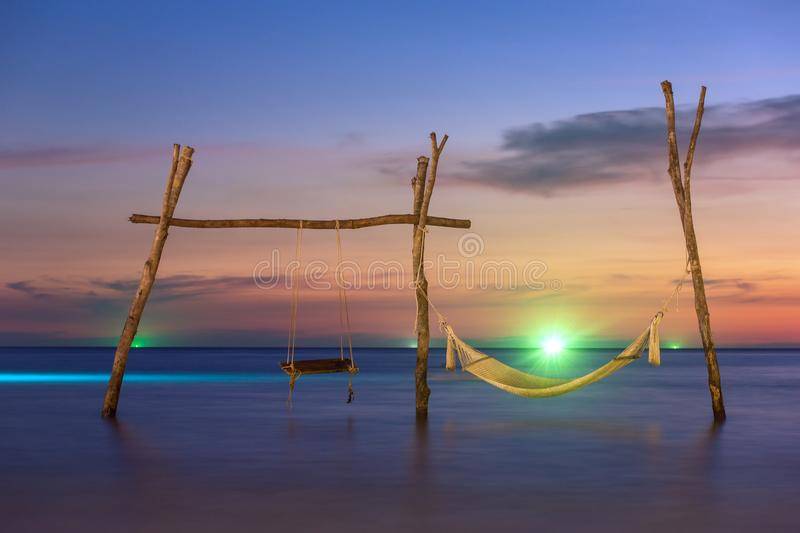 Wooden swing and hammock on the beach of Koh Kood island. In Thailand royalty free stock photos
