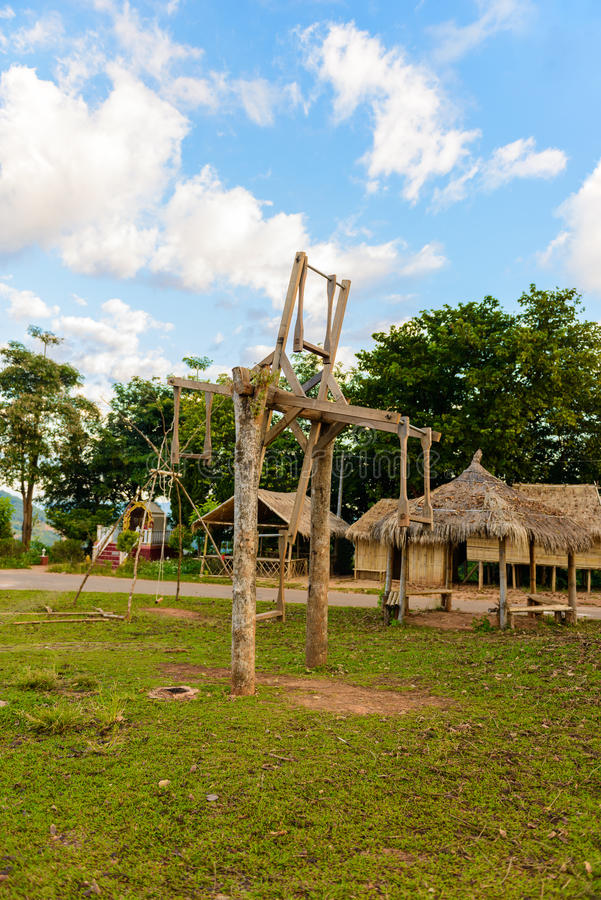 Wooden swing during the mountain tribe`s for new year celebrati royalty free stock image