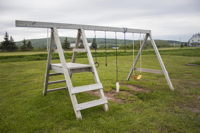 Wooden Swing Set. Outdoor wooden playground swing set in Nova Scotia royalty free stock photography