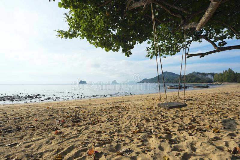 A wooden swing on the beach of Thailand royalty free stock photos