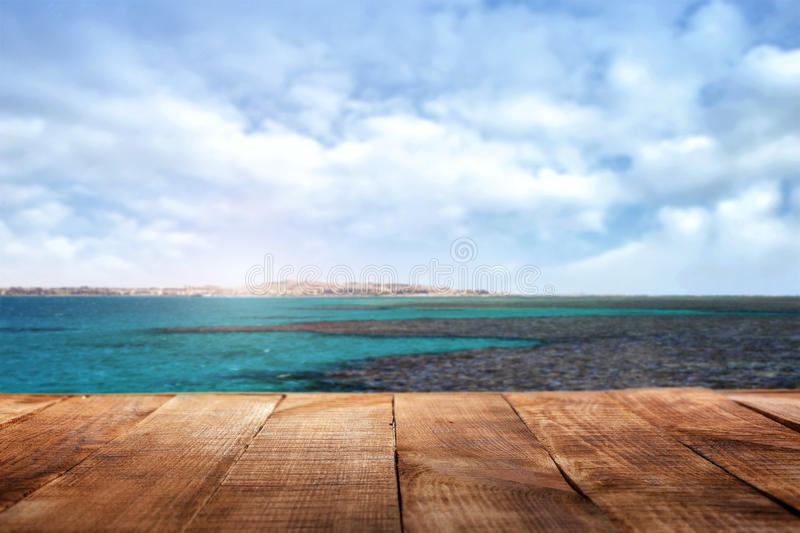 Wooden table in the background of the ocean and sky royalty free stock photos