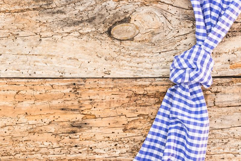 Old wooden table background for a menu card with blue checked tablecloth. Wooden table background rustic texture, with blue checkered tablecloth, high angel view stock photos