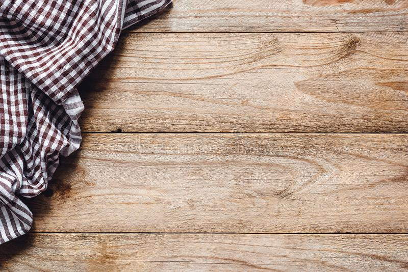 Wooden table background with textile. Food background. Wooden table background with kitchen textile or kitchen napkin. Cooking food, pizza table, picnic or food royalty free stock photos