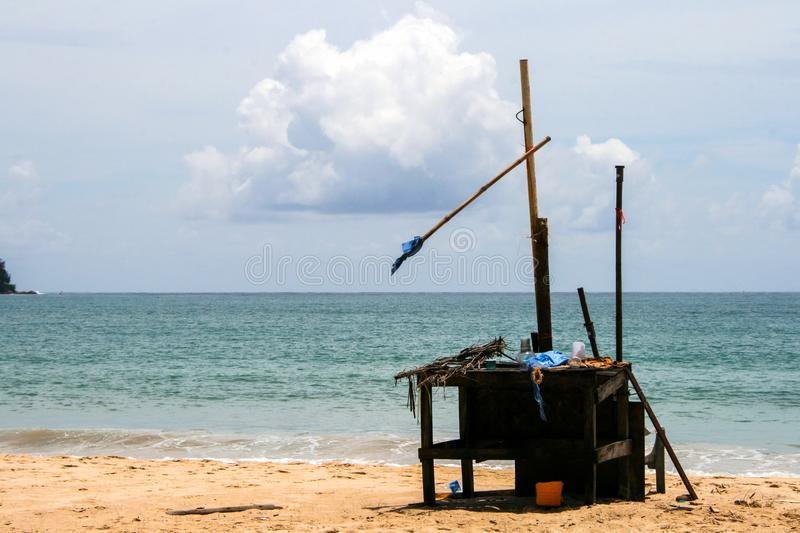 Wooden table on the beach. Seascape of Phuket on background of cloudy sky. stock images