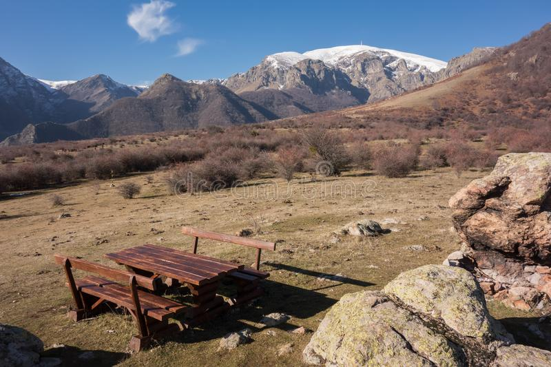 Wooden table and benches for tourist rest zone at the trail to Botev peak. Central balkan national park, Stara planina mountain, B stock photos
