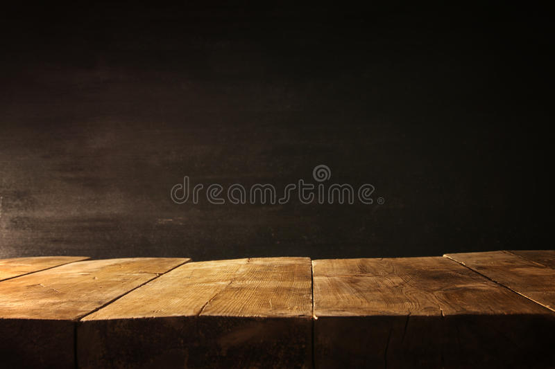 Wooden table and blackboard background. Ready for product display montage.  royalty free stock photography