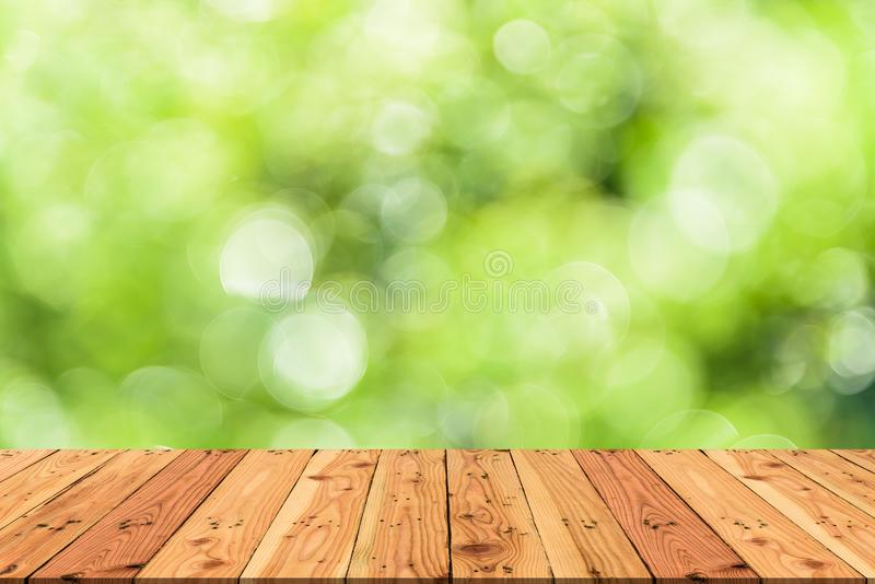 Wooden table on and blur nature tree green background. For spring or summer concept royalty free stock photos