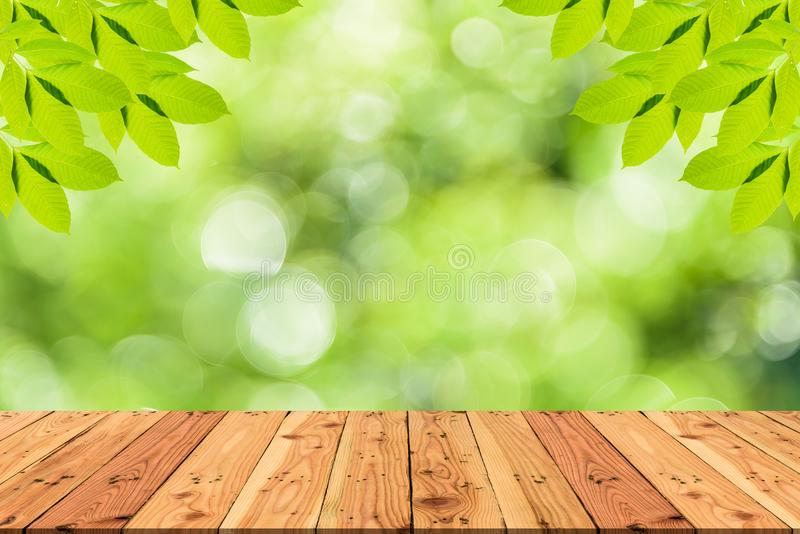 Wooden table on and blur nature tree green background for spring royalty free stock image