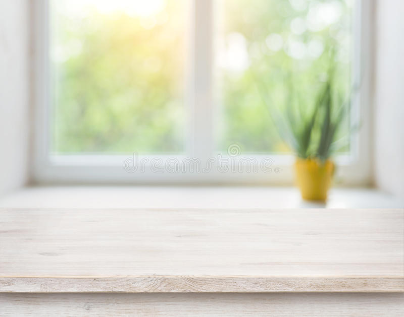 Wooden Table On Blurred Autumn Window With Plant Pot