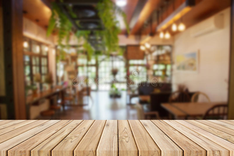 Wooden table with blurred of the restaurant background. Empty wooden table with blurred of the restaurant background royalty free stock photography