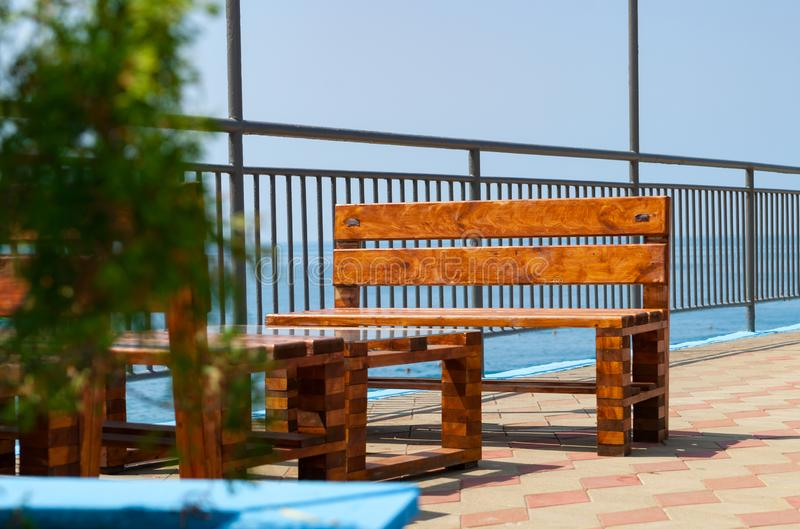 Wooden table in a cafe on the beach stock images