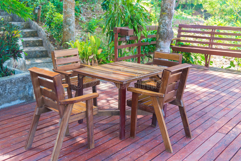 Wooden table and chair in resort and garden, dining set at wooden terrace in restaurant. royalty free stock photo