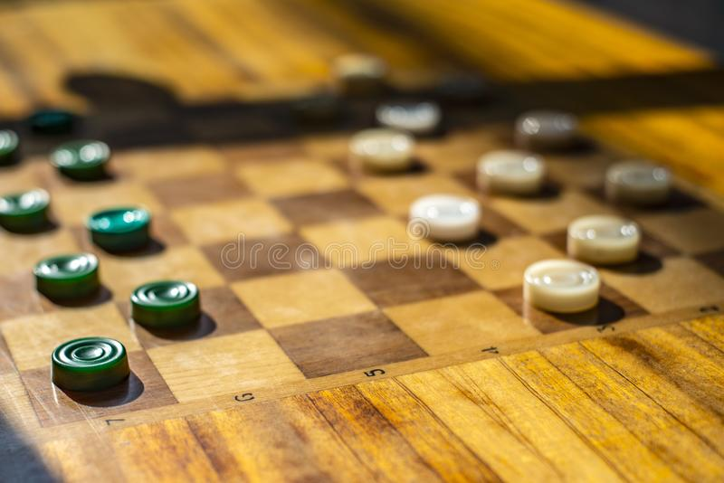 Wooden table with checkers in the games room.  royalty free stock photography