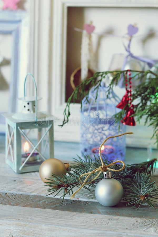 On a wooden table Christmas ball, cones, spruce branches, decorative lights, illumination. Decorate the interior for seasonal winter holidays stock image