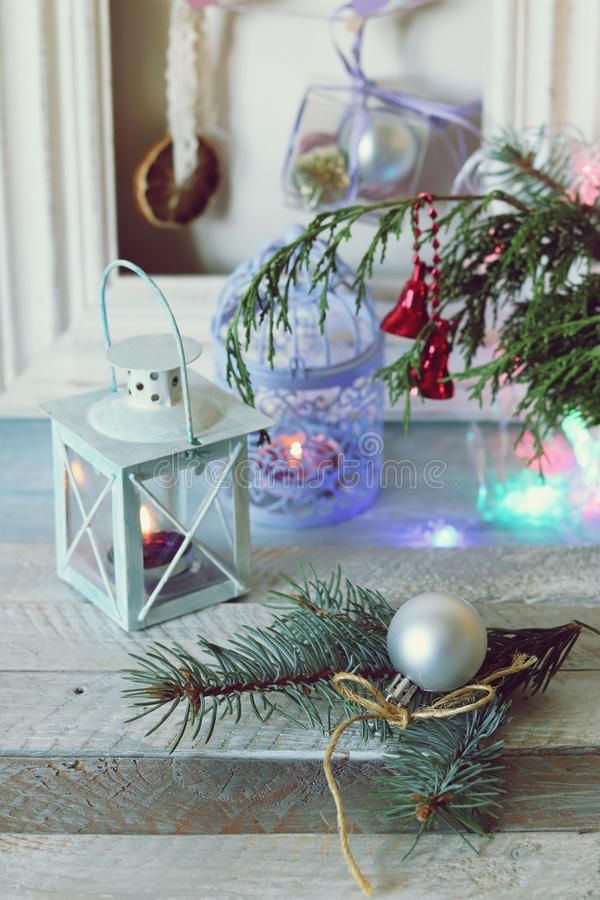 On a wooden table Christmas ball, cones, spruce branches, decorative lights, illumination. Decorate the interior for seasonal winter holidays royalty free stock images