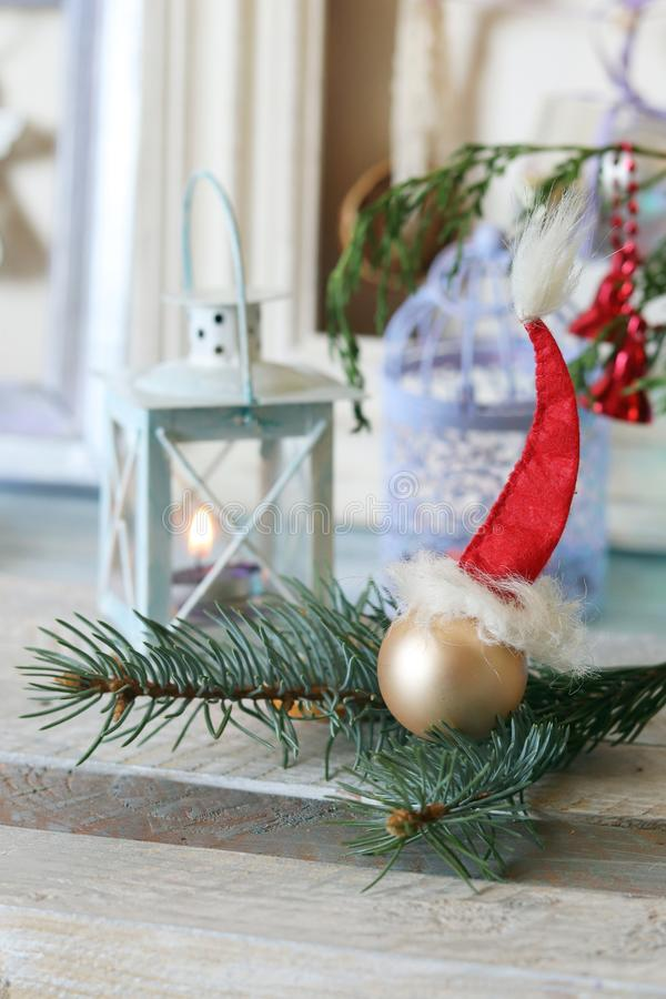 On a wooden table Christmas ball, cones, spruce branches, decorative lights, illumination. Decorate the interior for seasonal winter holidays stock photography