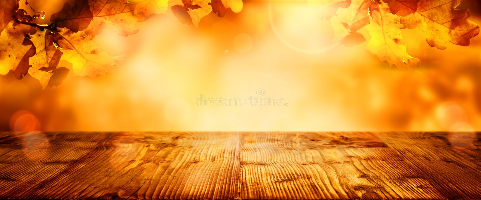 Wooden table with colorful autumn leaves royalty free stock photo