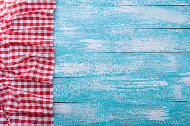 Wooden table covered with tablecloth cloth checkered red. Blue white wooden table covered with tablecloth cloth checkered plaid red stock photo