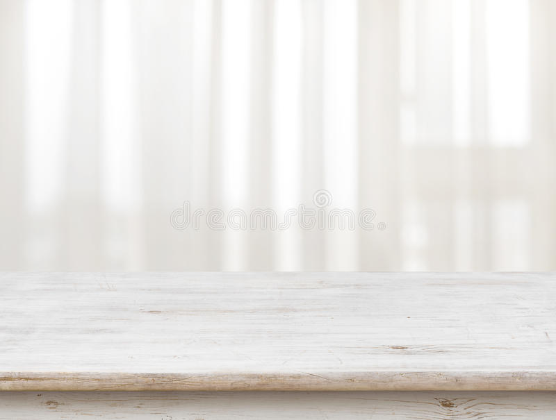 Wooden table on defocuced window with transparent curtain background.  royalty free stock photos