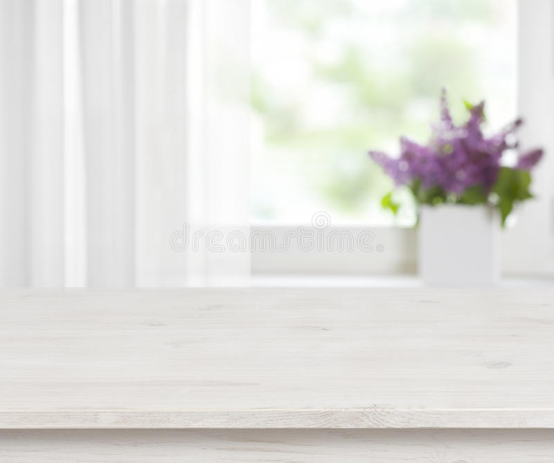 Wooden table on defocused window with purple flower pot background royalty free stock photography