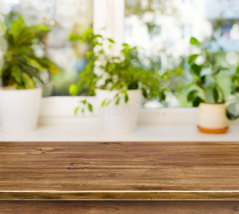 Wooden table on defocused windowsill background stock image