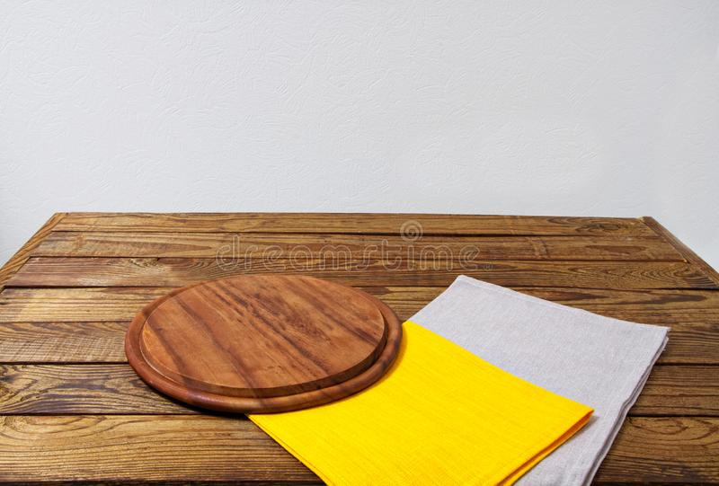 Wooden table, desk for pizza with coloured napkins. Holiday, food concept.  royalty free stock image