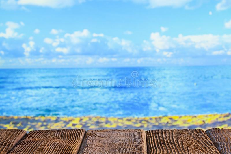 Wooden table with empty space on the beach. Brown wooden table with empty space on the beach stock photos