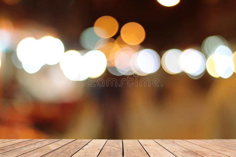 Wooden table on font and blurred warm orange colorful. Background stock photos