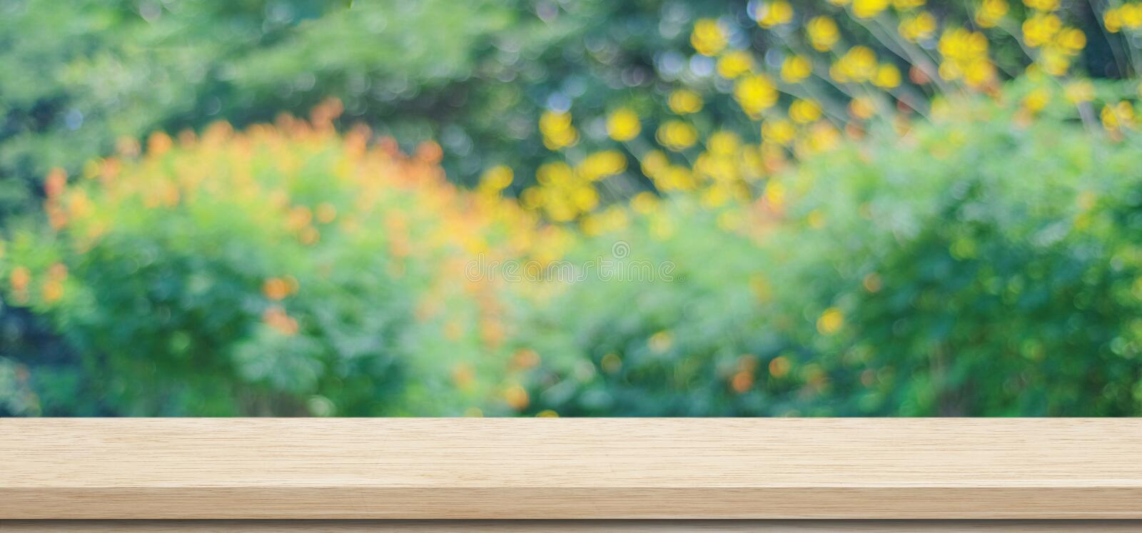 Wooden table for food, product display over blur green garden background, Empty wooden shelf, desk and blur tree park with bokeh stock photos