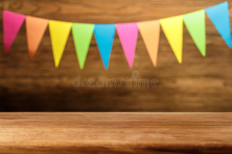 Wooden table in front of abstract blurred Christmas background f. Lags. Place for text. The oak table stock image