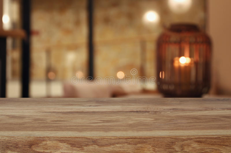 wooden table in front of abstract living room background stock images