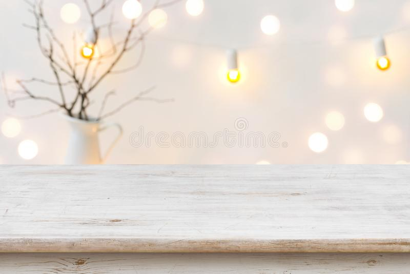 Wooden table in front of blurred abstract winter holiday background.  royalty free stock image